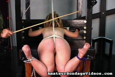 Stocks and bondages0. In the stocks and with her cunt straining under a tightly pulled rope, a girl endures a beating