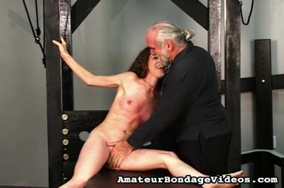 Bound and splayed. Nicole is helpless as she is bound and gagged on Master Lens slab