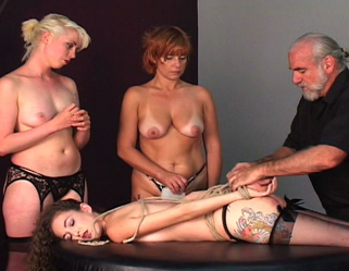Slave spankings galore0. The red headed slave spanks the blonde slave before both of them receive their punishment from Master Len.