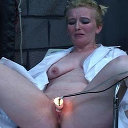 Blondie and the candle  blondie has her pussy covered in red hot candle wax as punishment for her slutty ways. Blondie has her vagina covered in red hot candle wax as punishment for her slutty ways.